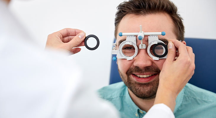 Smiling man having his face fitted for frames